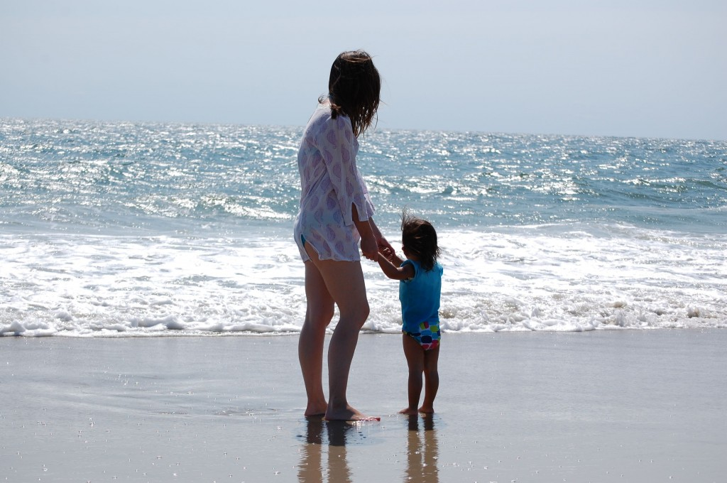 baby and mommy at the beach