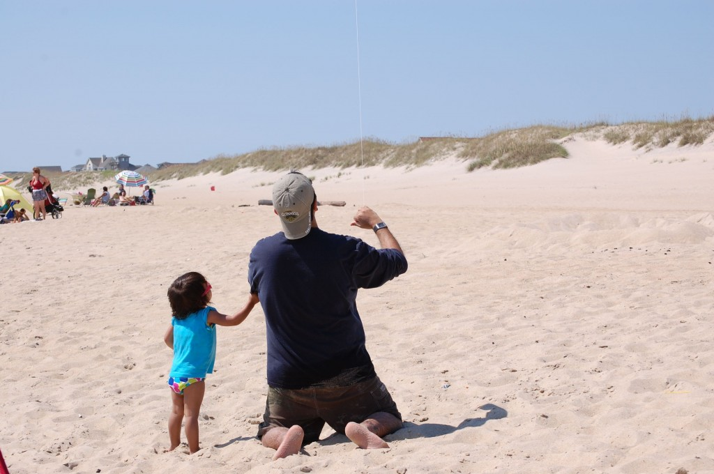 M and Baby flying a kite