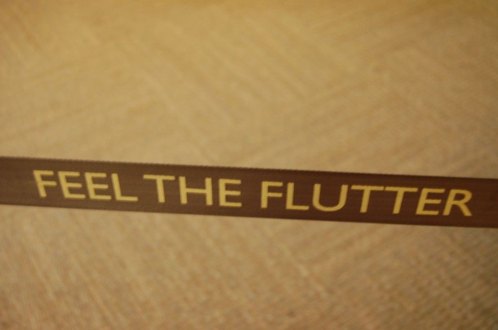 feel the flutter sign