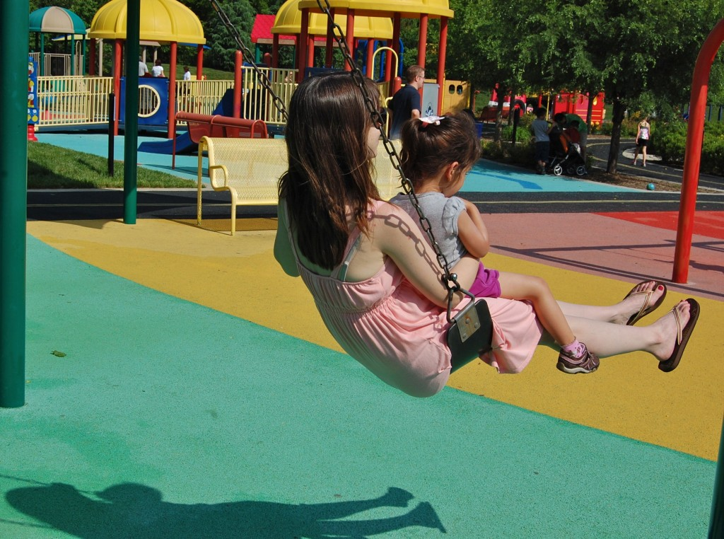 little girl and mommy on the swing