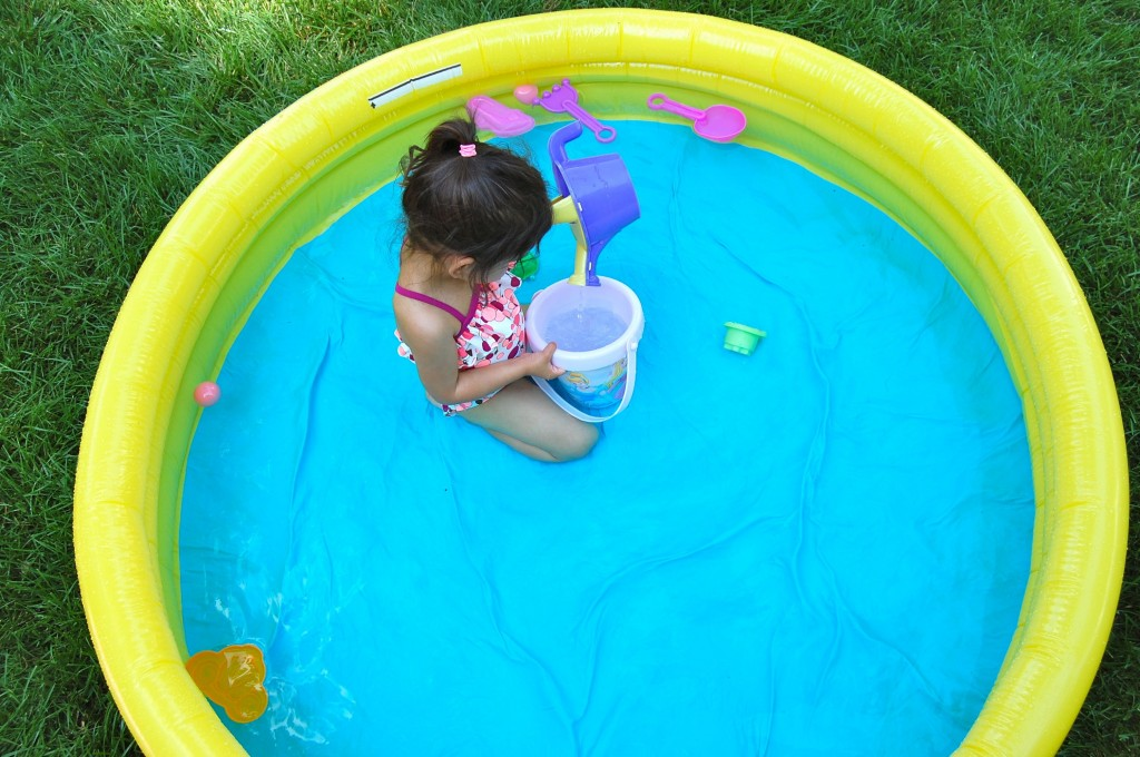 aerial shot of little girl in the pool