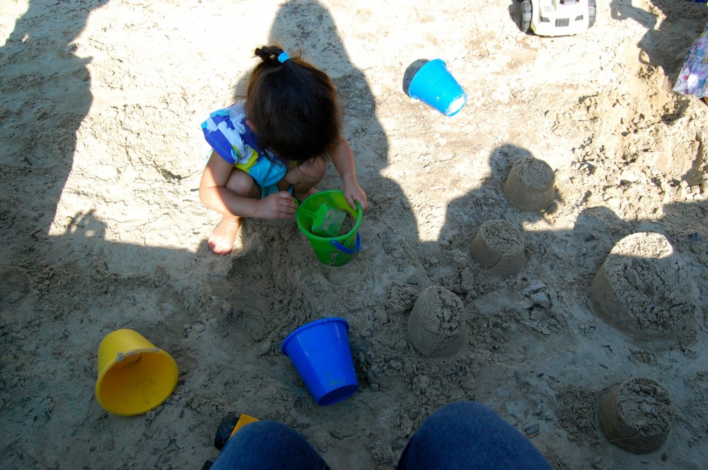 little girl in the sandbox