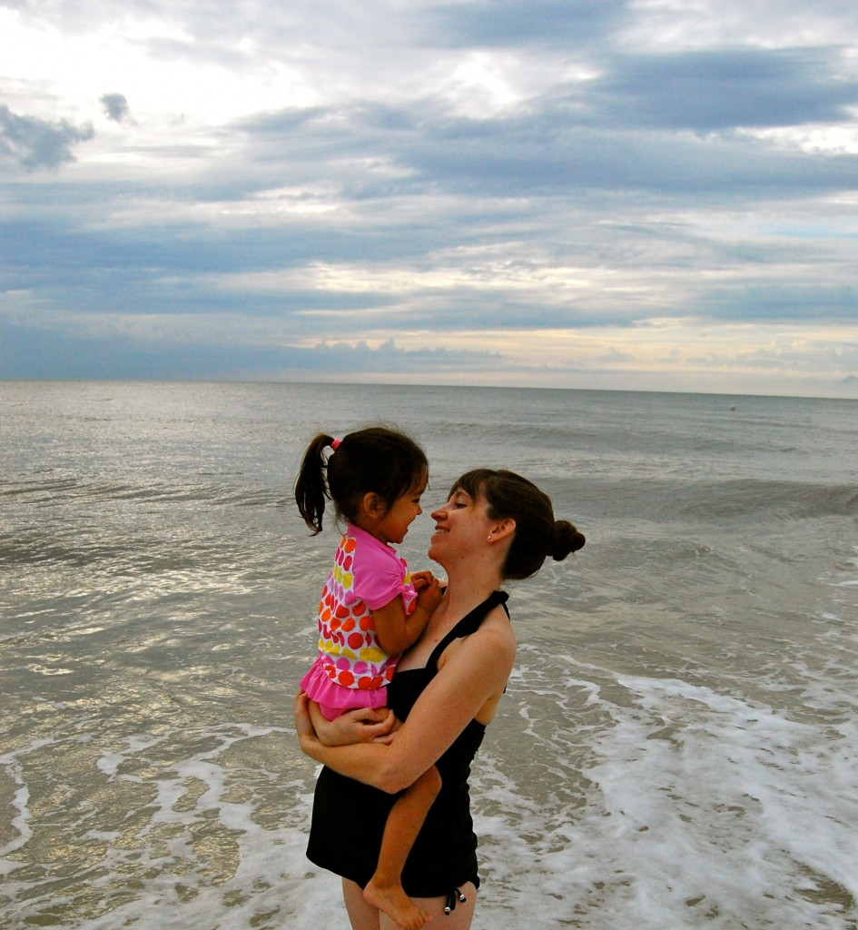 mommy and little girl at the beach