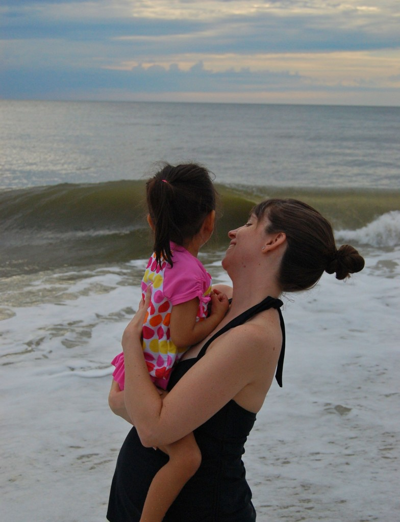 little girl with mama in the ocean
