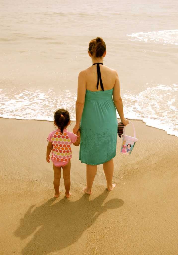 mommy and little girl on the beach