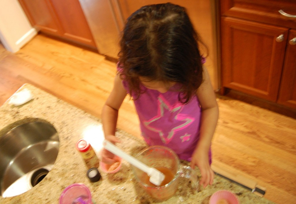 little girl mixing in kitchen