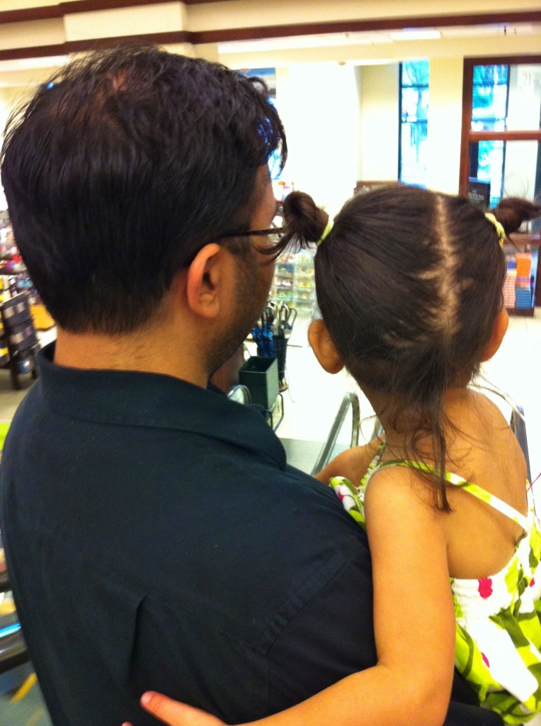 daddy and little girl on escalator
