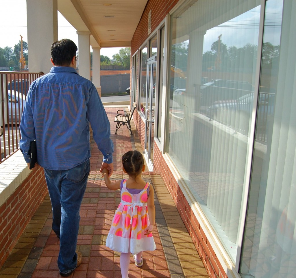 daddy and little girl walking to ballet