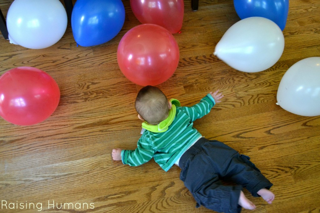 baby on tummy and balloons