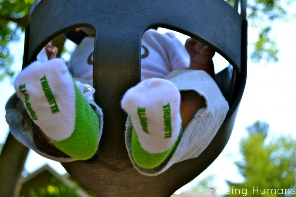 baby feet on a swing