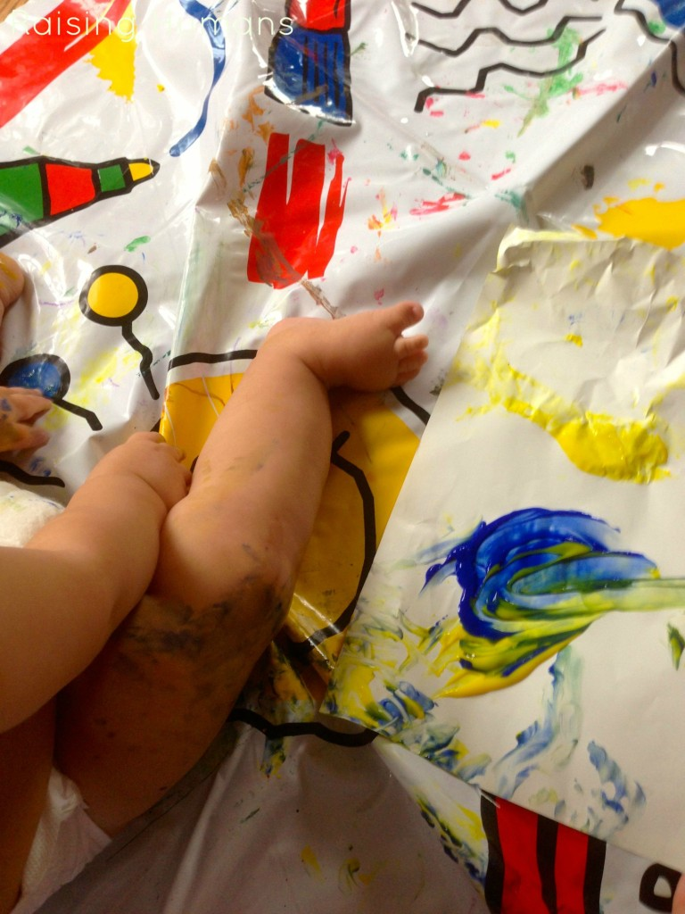 baby boy and paint