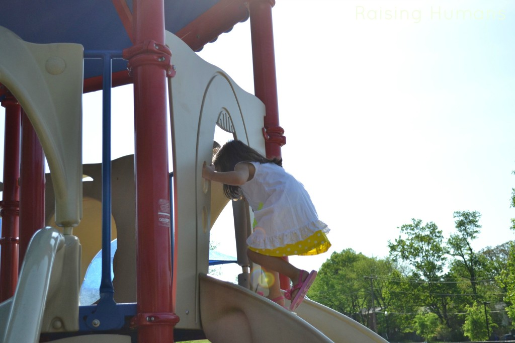 girl on top of slide